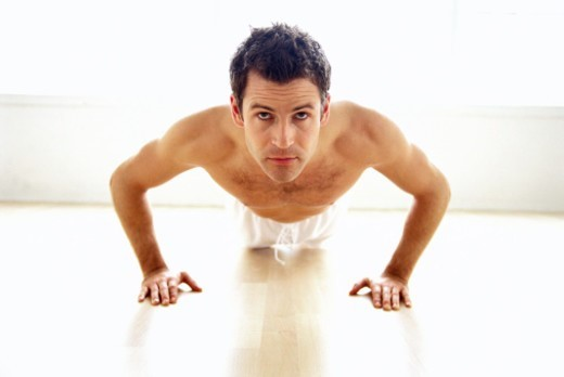 Stock Photo: 1491R-120075 portrait of a young man doing pushups