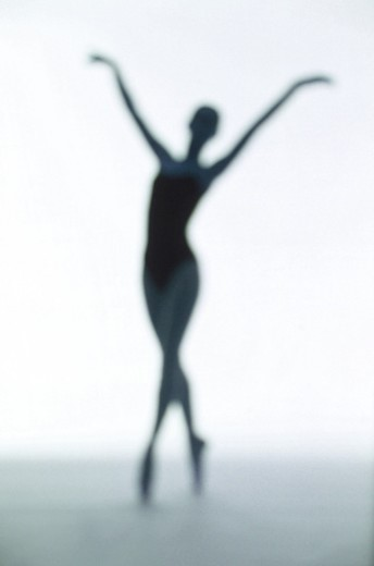 toned silhouette of a young woman performing ballet : Stock Photo