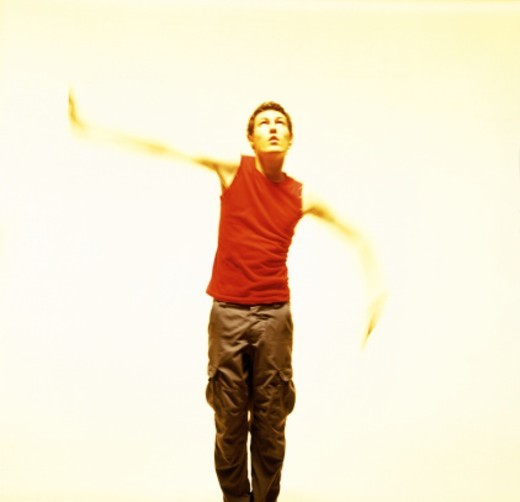 toned shot of a young man dancing : Stock Photo