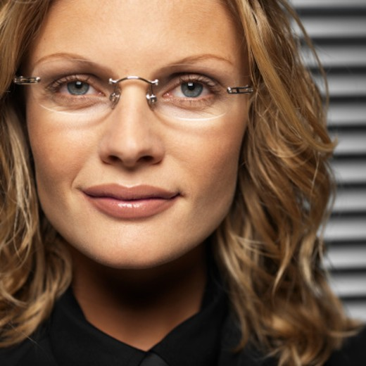 Stock Photo: 1491R-125145 Close-up of a young businesswoman wearing glasses