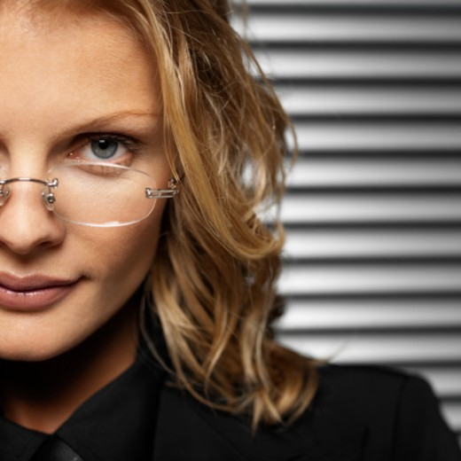 Close-up of a young businesswoman wearing glasses : Stock Photo