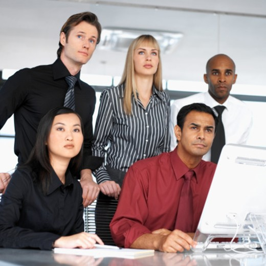 Low angle view of young executives at a meeting : Stock Photo