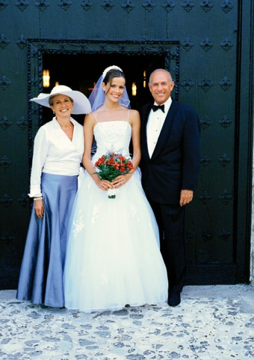Stock Photo: 1491R-131195 portrait of a bride standing outside the church with her parents