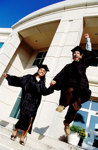 Stock Photo: 1491R-137146 low angle view of a young excited graduating couple