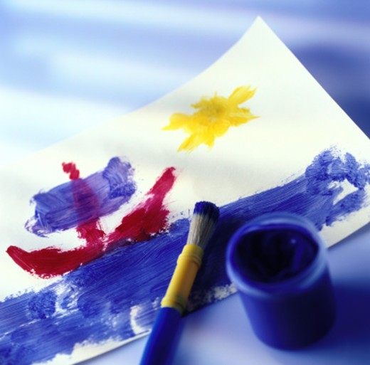 Stock Photo: 1491R-137275 close-up of child's painting with watercolor and paintbrush on it