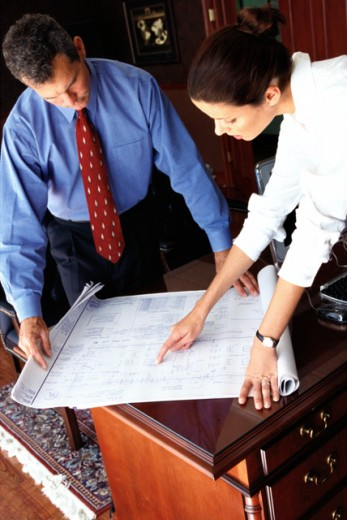 Stock Photo: 1491R-138064 high angle view of two business executives discussing plans