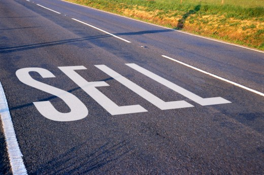 Stock Photo: 1491R-139060 view of a sign painted on the surface of the road saying sell