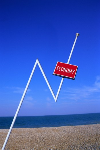 view of a road sign on a crooked post saying economy : Stock Photo
