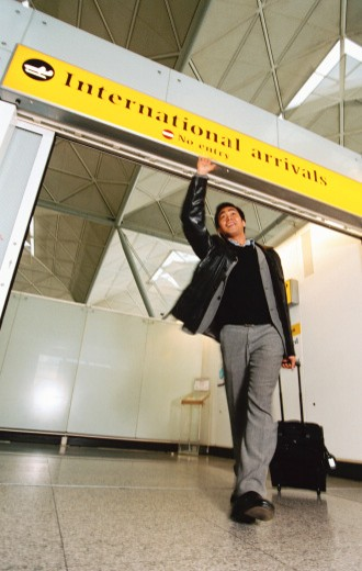 low angle view of a man waving from the airport arrival bay : Stock Photo