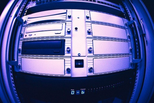 tungsten toned close-up of disk drives installed in a machine : Stock Photo