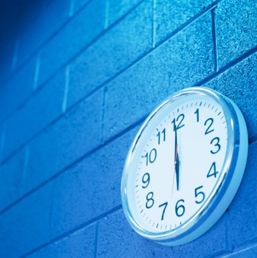 tungsten toned low angle view of a wall clock : Stock Photo