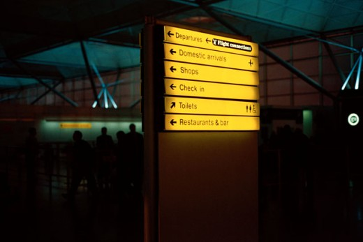 view of directions lit up on a board at an airport : Stock Photo