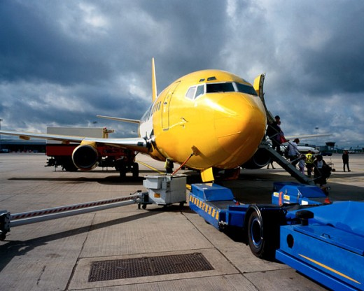 Stock Photo: 1491R-147071 view of the front of an aircraft being refueled at an airport