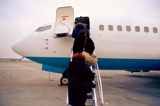view from behind of passengers boarding an aircraft : Stock Photo