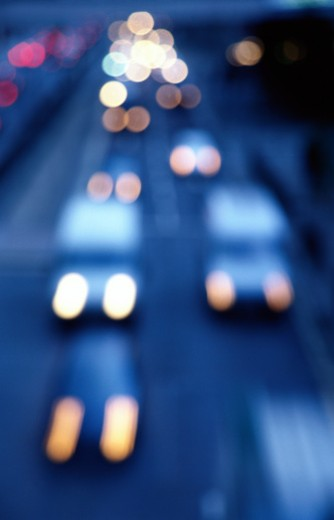 blurred high angle view of cars driving on a street : Stock Photo