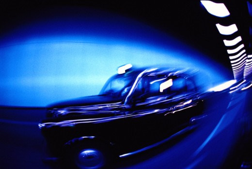 tungsten toned shot of the side of car moving in a tunnel : Stock Photo