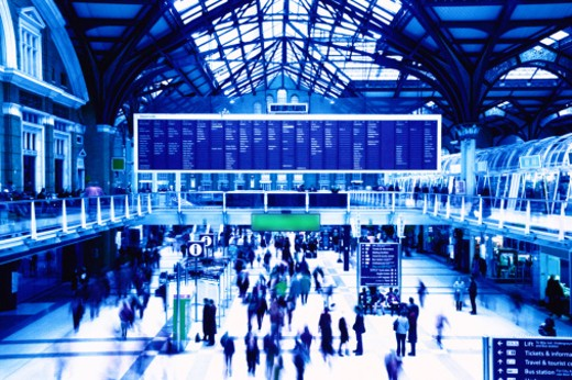 blurred high angle view of people at a train station : Stock Photo