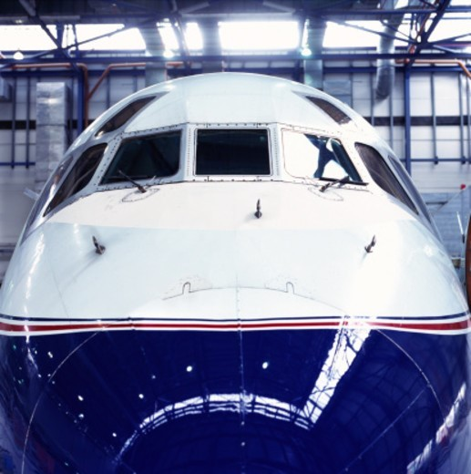 close up of the nose of an aircraft parked in a hanger : Stock Photo