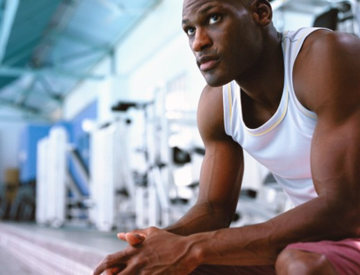 Stock Photo: 1491R-148143 low angle close-up of a man sitting in a gym