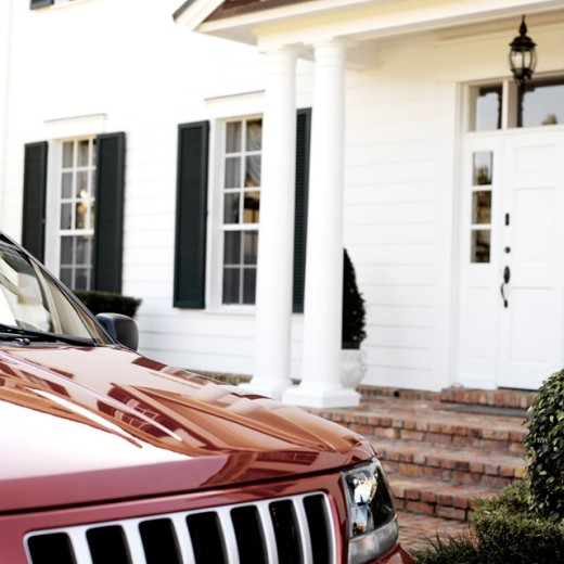 Close-up of a car parked in front of a house : Stock Photo