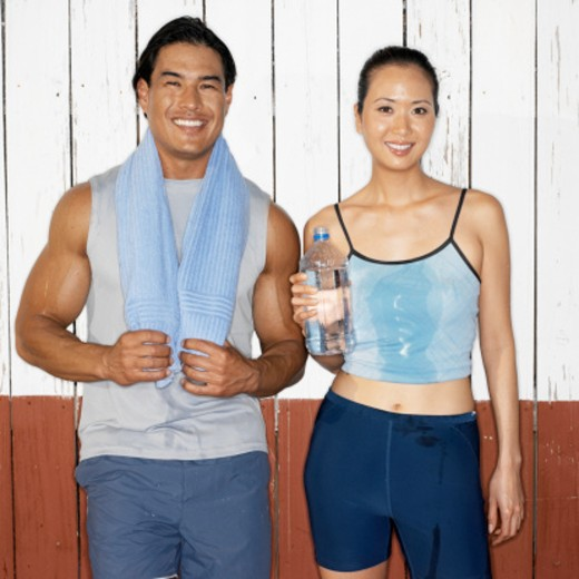 Stock Photo: 1491R-151146 Portrait of a young couple after a work out