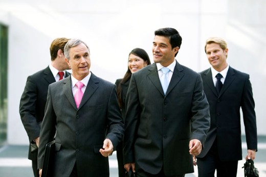 Stock Photo: 1491R-153147 Business executives walking and talking together