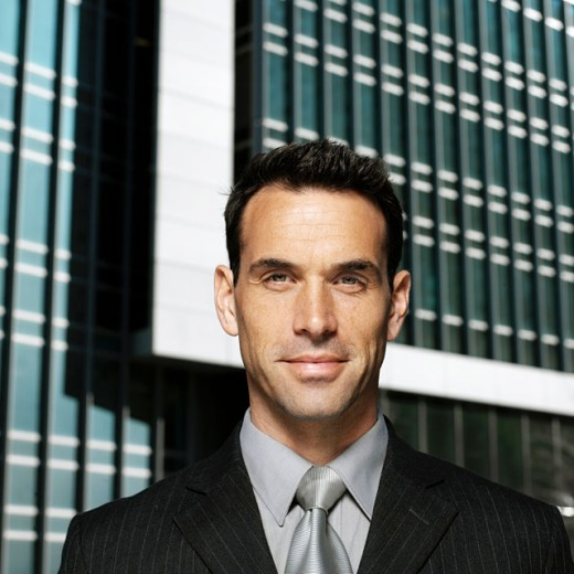 Portrait of a young businessman smiling : Stock Photo