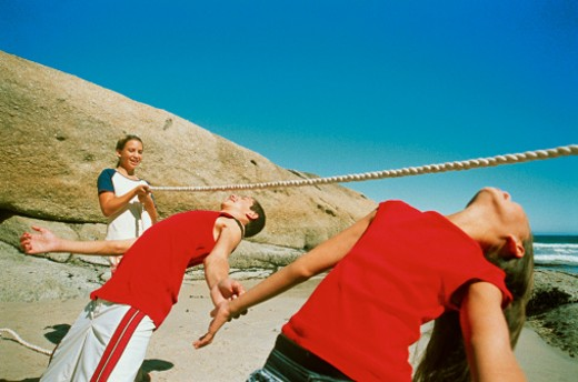 a group of young teenagers doing the limbo (14-16) : Stock Photo
