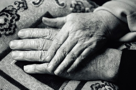 Close-up of a mature couple holding hands (black and white) : Stock Photo