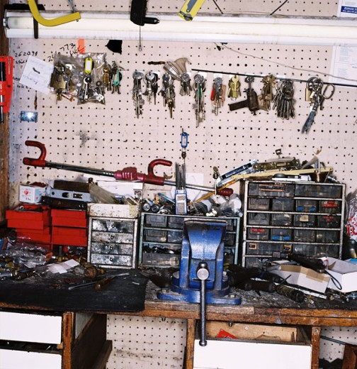 Stock Photo: 1491R-164131 counter top of a key maker with an array of tools and keys on it