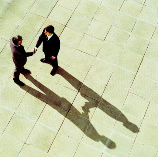 high angle view of two businessmen shaking hands : Stock Photo