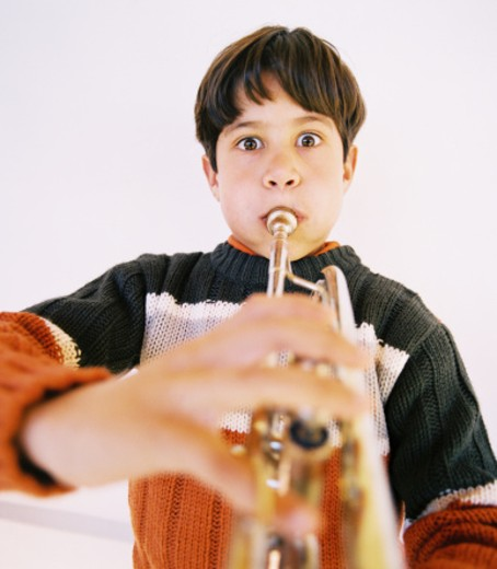 Stock Photo: 1491R-172098 close-up of a teenaged boy playing a trumpet