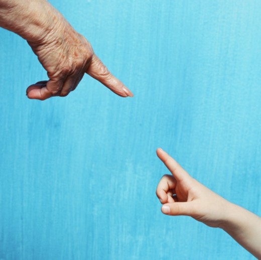 Stock Photo: 1491R-179091 view of the index finger of an elderly person and a young person