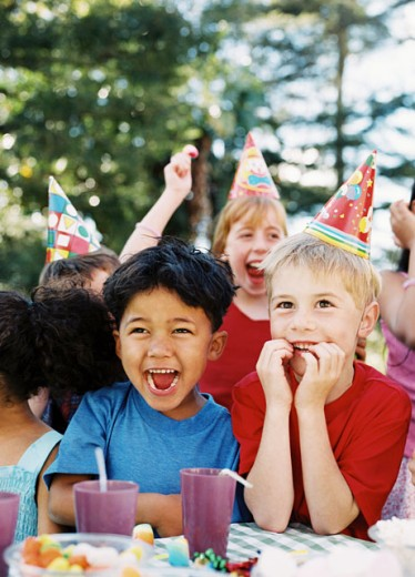 view of children enjoying a birthday party : Stock Photo