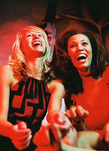 low angle view of two women at a restaurant laughing : Stock Photo
