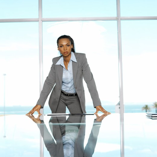Stock Photo: 1491R-219030 portrait of a businesswoman standing in a conference room