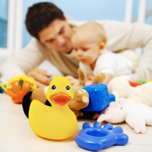 father playing with toys with his baby (6-12 months) : Stock Photo