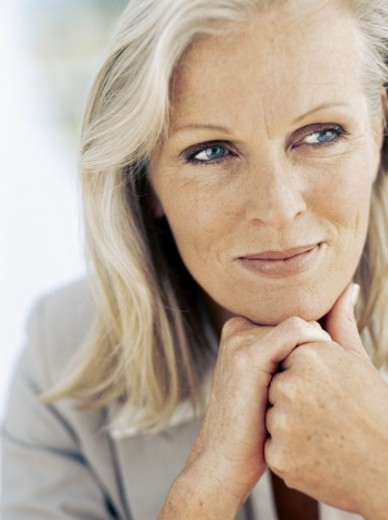 close-up of a businesswoman with her hand on her chin : Stock Photo