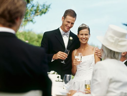 Stock Photo: 1491R-239025 bride and groom celebrating with their guests