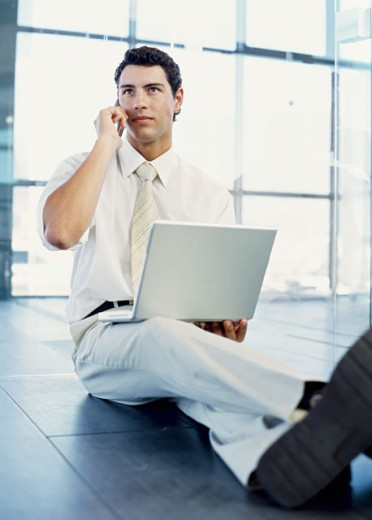 businessman talking on a mobile phone in an office : Stock Photo