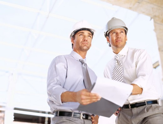 Stock Photo: 1491R-243034 architects holding a clipboard at a construction site