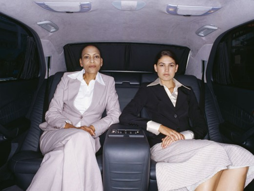 portrait of two businesswomen sitting in a car : Stock Photo