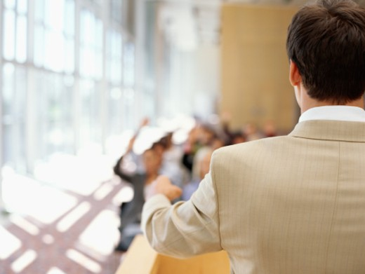 Stock Photo: 1491R-245032 rear view of a businessman giving presentation at a seminar