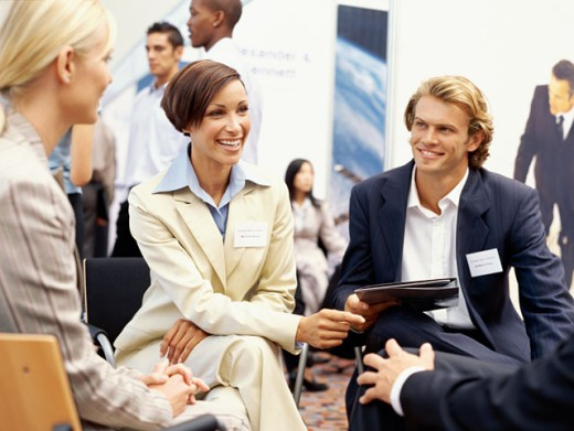 business executives discussing at an exhibition : Stock Photo