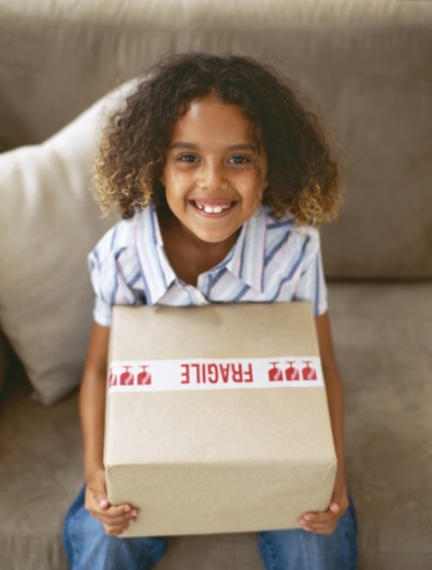 high angle view of a girl holding a cardboard box : Stock Photo