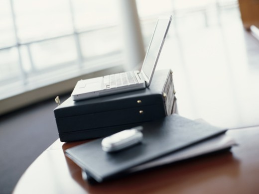 Stock Photo: 1491R-250015 close-up of files and a briefcase on a table in an office