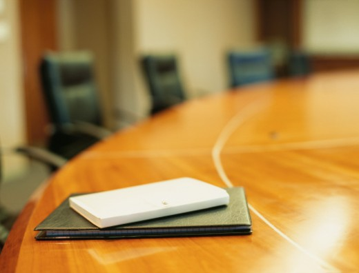 empty conference room with a diary on a conference table in an office : Stock Photo