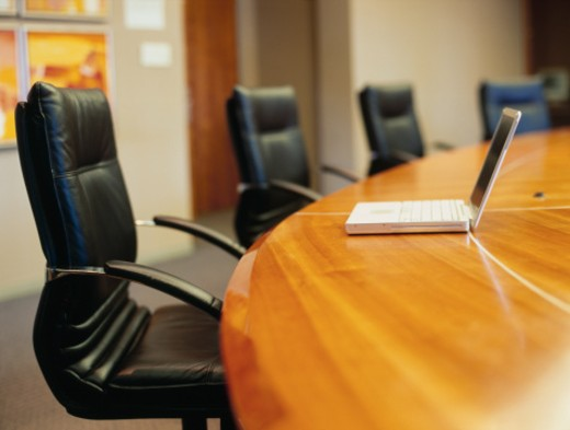 empty conference room with a laptop on a conference table in an office : Stock Photo