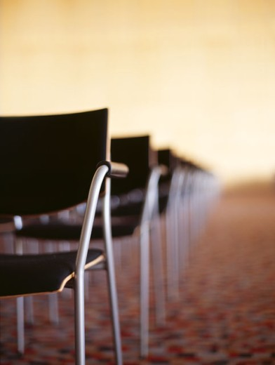 Stock Photo: 1491R-250050 chairs in a row in a conference room