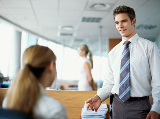 Stock Photo: 1491R-254088 three business executives talking in an office